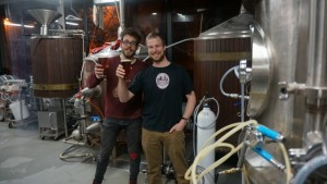 Wig and Pen brewer Frazer Brown, left,  toasts the release of Tom Dixon's Wig and Pen Trophy beer, a Dusseldorf Altbier.