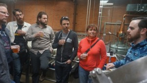 Canberra Brewers get the low-down on the Young Henrys brewing operations from assistant brewer Owen Lyons, far right.